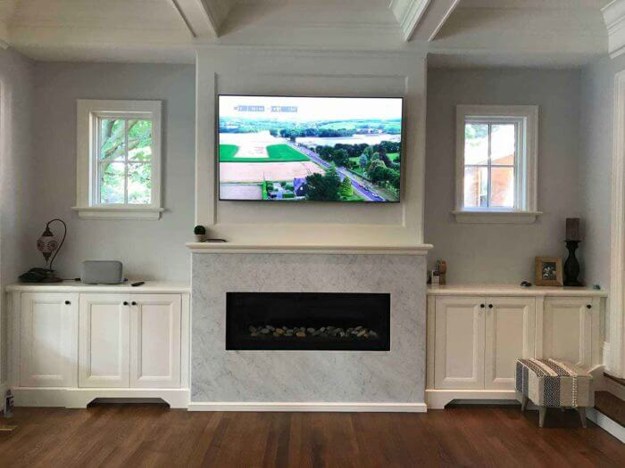 tv-mounted-above-natural-fireplace